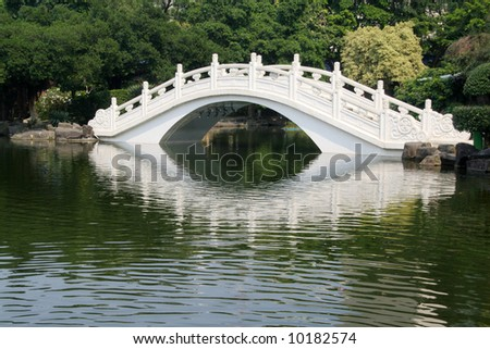 White bridge in an Asian garden