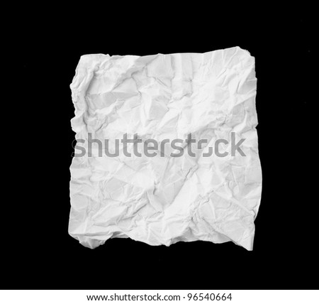 White broken and creased paper note isolated on a black background.