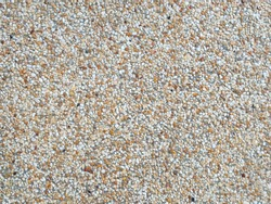 White brown pebble texture granite wall for background image.