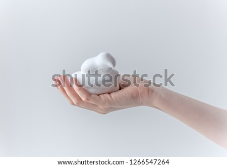 white bubbled foam in hands, hair foam, foam for man, white textured, hand full of soap isolated on white background