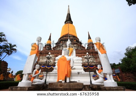 White Buddha images in front of ancient pagoda in Ayuthaya, Thailand