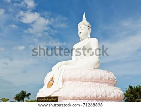White Buddha statue with blue sky.