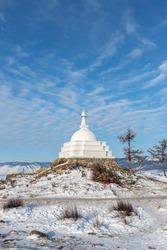 White Buddhist stupa of enlightenment on  Ogoy Island, Baikal Lake, Russia