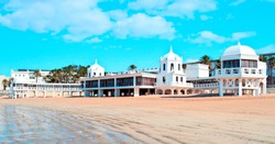 White building located on the beach in the cove in the Spanish city of Cadiz