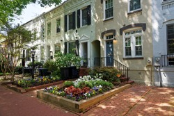 White building pictured in Georgetown neighborhood in Washington D.C., United States of America. The city was approved by the signing of the Residence Act in 1970 and in 1801 it was organized.