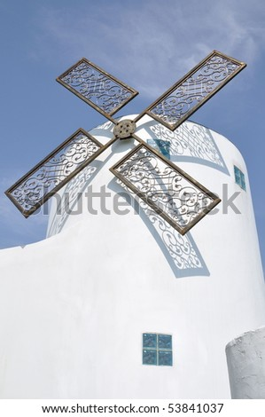 white building with a windmill
