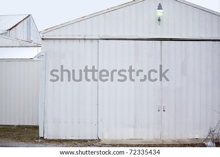 white buildings with siding