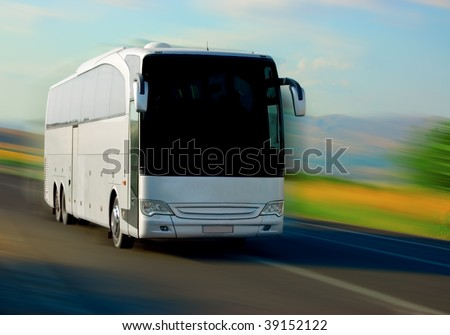 white bus on the road