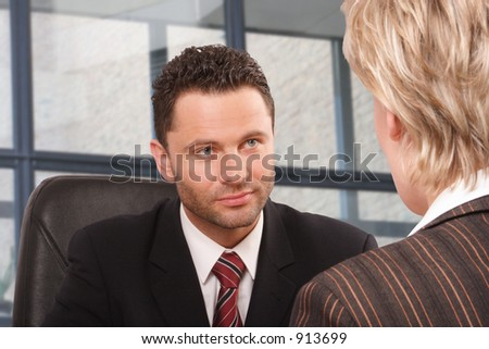 White business man and woman talking in the office building