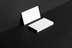 White businesscards on black background close up, copy space