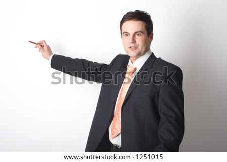 white businessman in suit pointing at blank white space