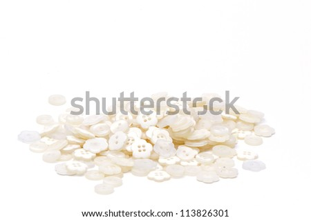 White buttons on white background.
