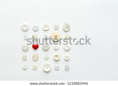 white buttons with red heart