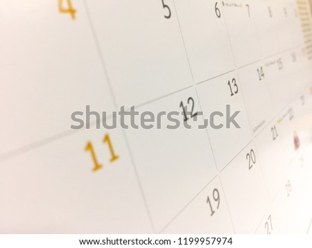 White calendar is adjusted with brown tone, the month are sort by date as the square table which was empty space. Picture in blurred background, for wallpaper or backdrop