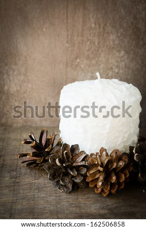 white candle and pine cone, christmas