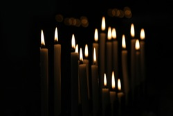 White Candle flames on a black background