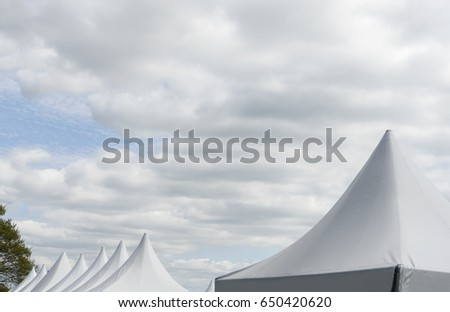 White Canvas Event Tents Against Blue Sky, Top Of Party Tents At The Park #650420620
