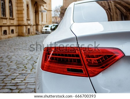 White car and lands-paces.  Icheri She her (Old Town) of Baku, Azerbaijan. Street in old town, fortress, Baku, Azerbaijan.