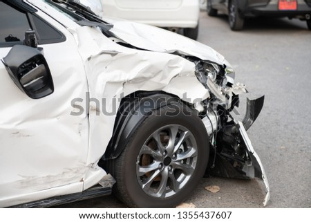 White car crash accident on the road damaged automobiles. #1355437607