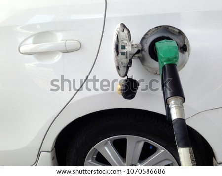 White car fuel filler at fuel station. Fuel dispenser at gas station. #1070586686
