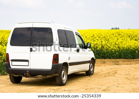 white car, with yellow field