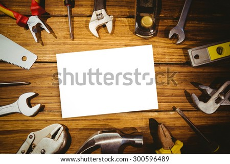 White card against tools on desk
