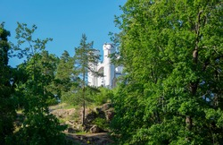 White castle of Mon Repos or Monrepos, extensive English landscape park in the northern part of the rocky island of Linnasaari (Tverdysh, Slottsholmen) outside Vyborg, Russia
