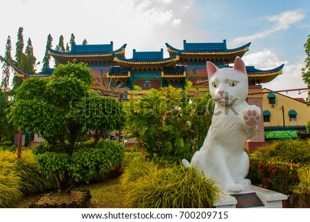 White cat monument is the Kuching South City Council Cat Statue. Sarawak Malaysia. his monument is a landmark for Kuching city and popular photo spot with locals and tourists. #700209715