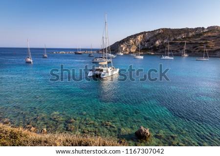 White catamaran docked in ancient bay of Knidos against blue sky. Datca peninsula, Mugla, Turkey. #1167307042