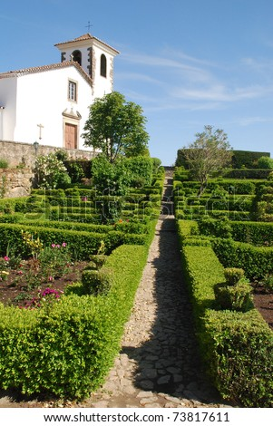 white cathedral and ornamental garden in medieval village Marvao (13th century) on the serra of Alto Alentejo (Portugal) .