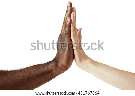 White Caucasian female and black African American male holding hands together in world unity, racial love and understanding concept. Close up shot of two people of different cultures giving five.