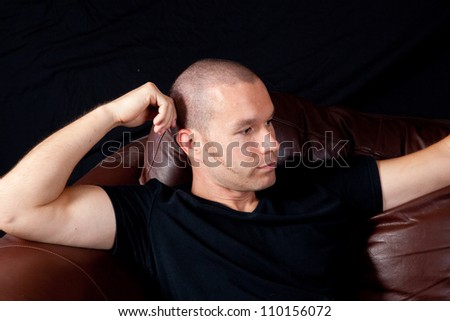 White Caucasian man sitting and thinking