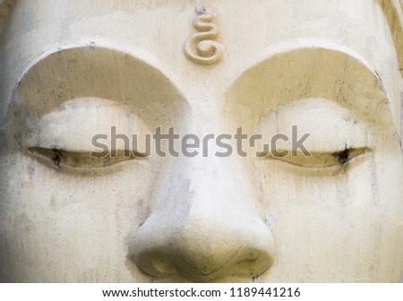 White cement Buddha image face, religion concept, Buddhism symbol