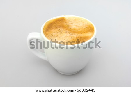 White ceramic cup from coffee on a white background