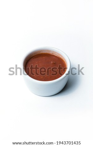 White ceramic saucepan with sauce on a white background Сток-фото ©