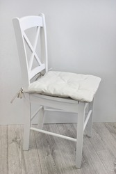white chair with padded seat, chair cushion
