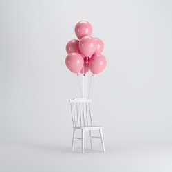 White chair with Pink balloons floating on white background. minimal party concept idea.