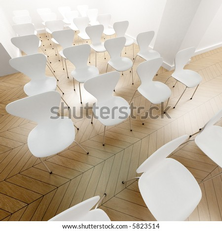 White chaires neatly arranged for a conference