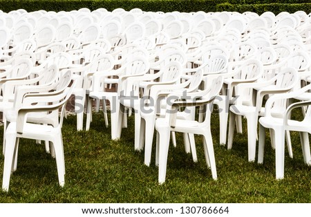 White chairs set up for open air concert