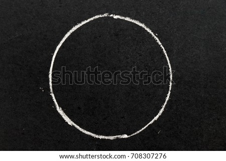 White chalk hand drawing as circle shape on black board background #708307276