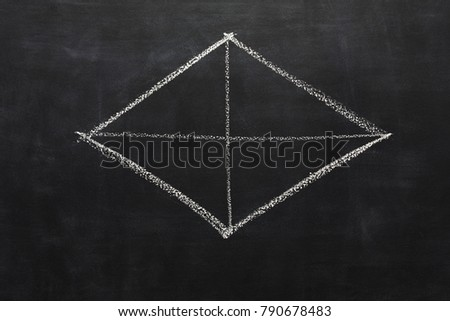 White chalk hand drawing rhombus on blackboard. Geometrical shape on black educational background with copy space #790678483