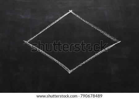 White chalk hand drawing rhombus on blackboard. Geometrical shape on black educational background with copy space #790678489