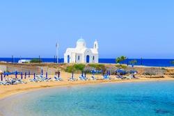 White chapel on a shore