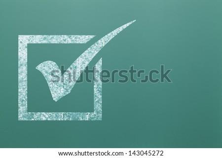 White Check Mark in Box on Green Chalk Board.