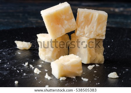 White cheddar cheese cubes on black slate