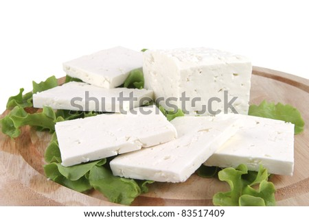 white cheese on wooden plate with salad