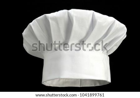 white chef's hat on black Foto stock ©