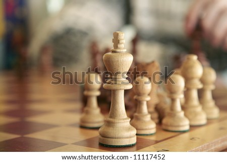 white chess figures on a playing board