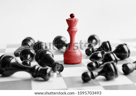 White chess queen beats blacks on chessboard over white background. Win and success concept, copy space