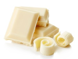 White chocolate pieces and curls isolated on white background